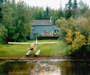 FROM FAIRBANKS PADDLEBOAT YOU SEE EVERY HOME HAS A FLOAT PLANE IN THE BACKYARD