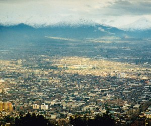 The sprawling city of Santiago nestled with the backdrop of snow capped Andes