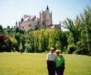 My bridesmaid Sandra and me outside Segovia's Alcazar with its turrets.