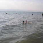 Colleen reading and floating in the Dead Sea