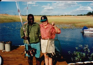 Colleen and guide fishing for tiny bream Lake Karibe
