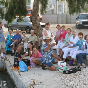 Group having drinks at sundown at Sami Beach Kefalonia