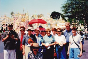 HWT Cowra group at Disneyland, follow the red umbrella