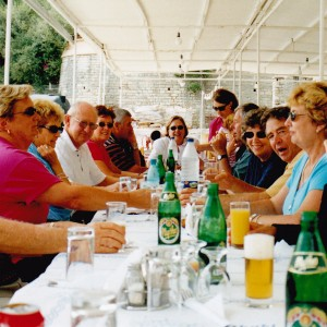 Group dining at a taverna in Ithaca on the day cruise
