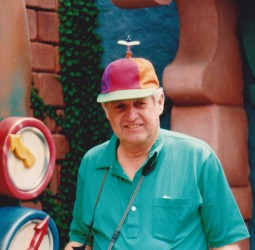 The group gave John a propeller hat in Disneyland.