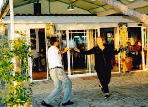 Michelle and our coach driver demonstrating Greek dancing at the sunset dinner