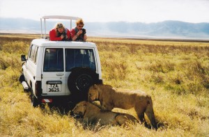 Caroline Foster and me on safari in Ngorongoro Crater. Book end lions