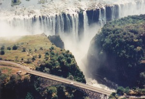 Victoria Falls from a helicopter looking down on bridge to Zambia