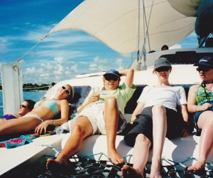 """On the day cruise around Mauriius girls lazing on board, this is called """"work"""" for travel agents!"""