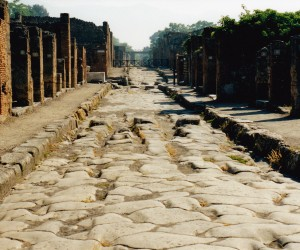 POMPEII ROADS NOTE SPEED BUMPS CARRIAGE TRACKS IN WATER DRAIN