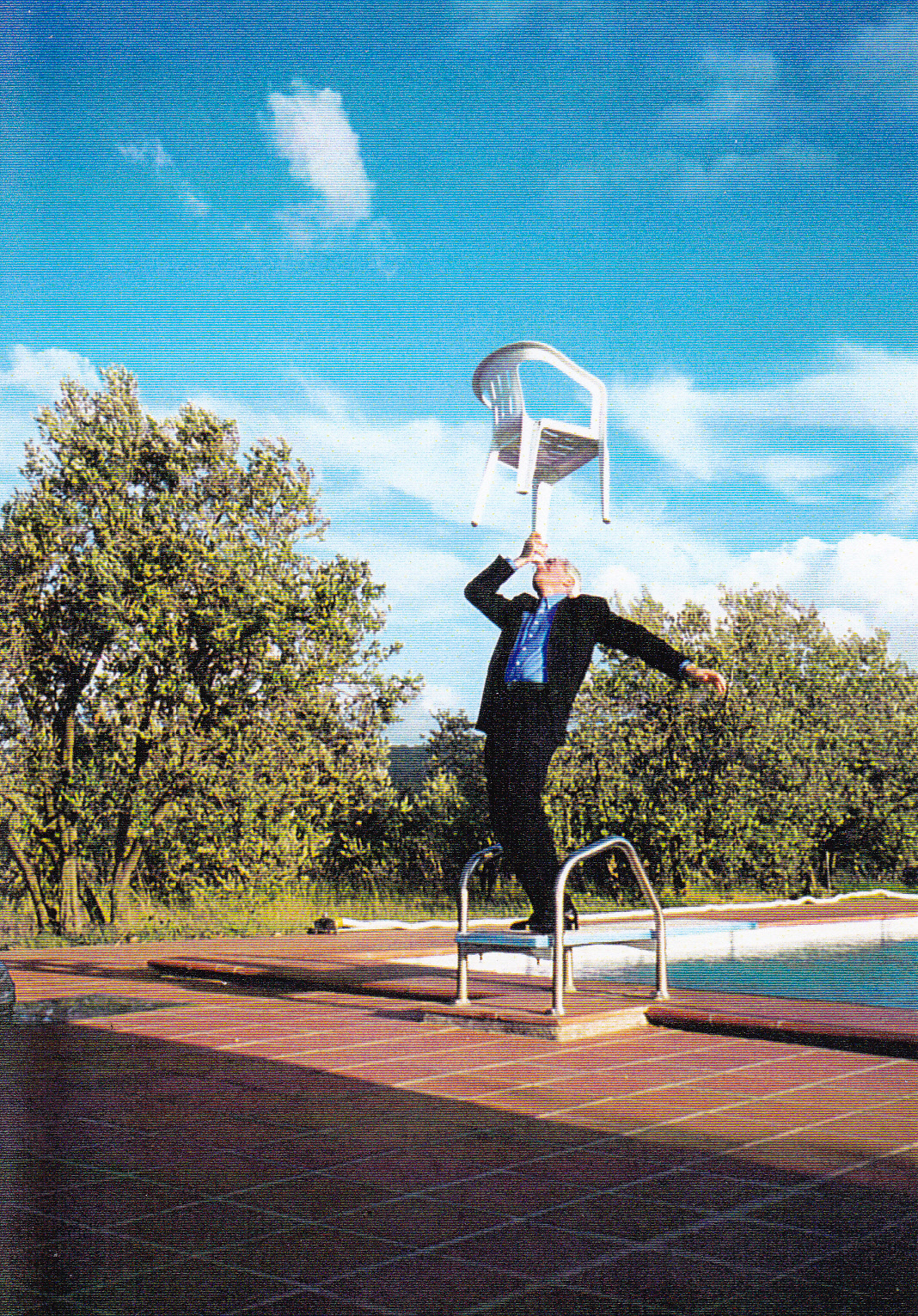 ROBERTO DOING BALANCING ACT AT VILLA LA FORRA POOL