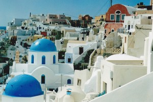 Beautiful Oia in Santorini with its blue domed churches.