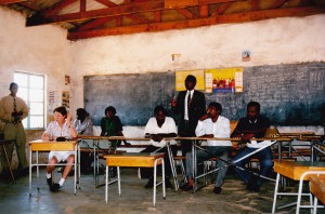 Jan Winters one of our group sitting in the Baobab School Victoria Falls