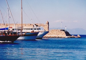 The bluest water in Rhodes harbour at the city wall gate where 280BC the 30 metre high Colossus of Rhodes stood until destroyed by earthquake in 226BC