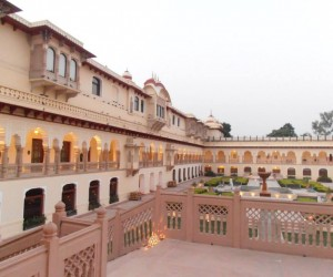 Rambagh Palace courtyard lovely gardens with pigeon chasing man