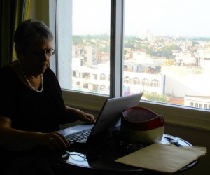 Michelle setting up reporter's desk at our fifth floor room Gateway Hotel see Taj in background