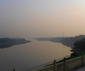 Yamuna river bathed in ethereal light adding mystery to the Taj Mahal